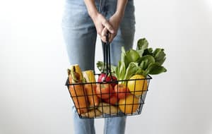 grocery store aisle basket with fruit