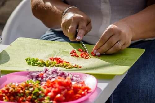 chopping colorful veggies