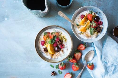 berries and yogurt breakfast with scattered strawberries