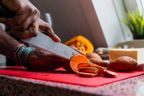 chopping sweet potatoes