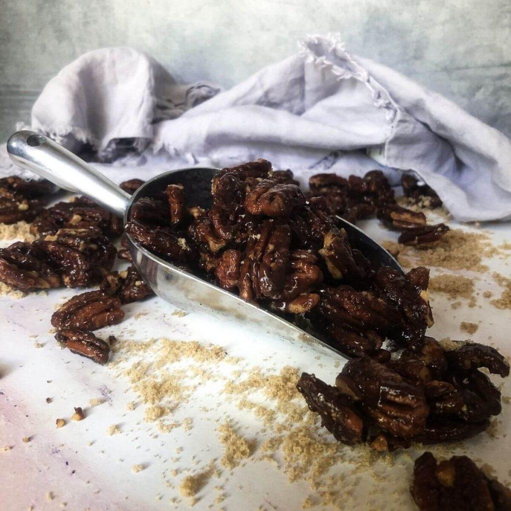 Vegan Candied Pecans in Metal Scoop