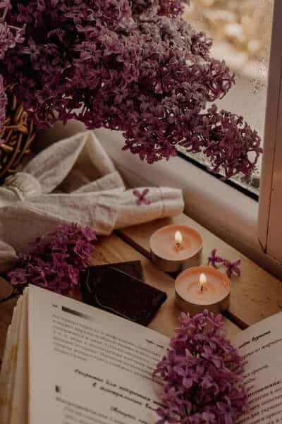 lavender with candles and a book