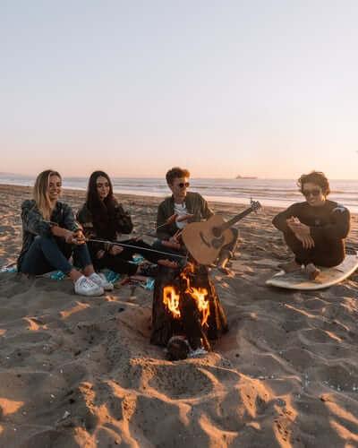 4 people around campfire