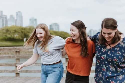 Three girls walking and laughing