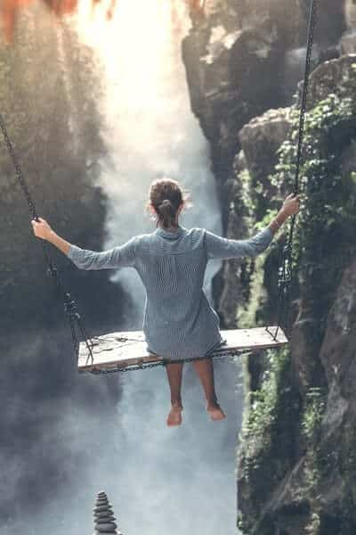 Woman on swing over water
