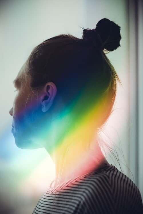 Woman with rainbow shadow