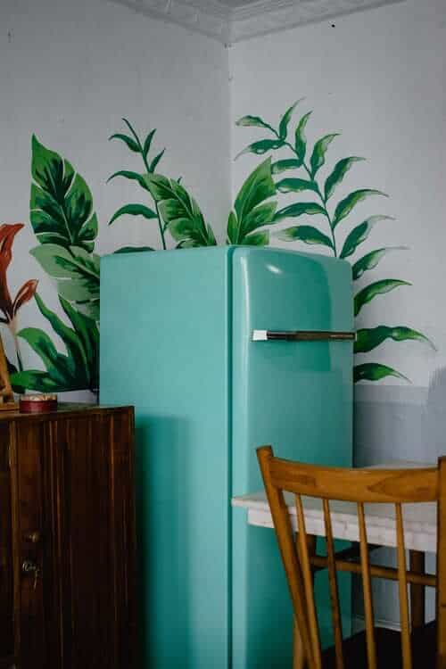 Blue fridge, table and chairs