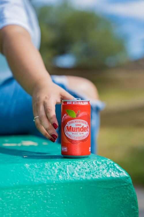 woman grabbing red soda