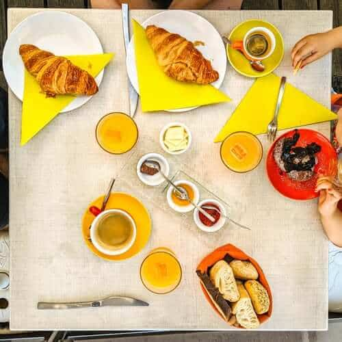 breads and sauces on yellow paper